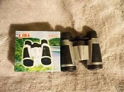 Lida Binoculars 6 X 30. Plastic with neck cord.