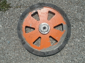 "Pully. Orange. Used. 16 3/8"" Diameter. 3/4"" ID on Bearing"