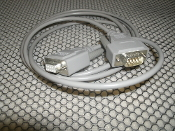 UPS 940-0095A. 9 Pin Female to 9 Pin Male Connector. New. Grey. 94000995A. lOlOl. AWM E101344. 2464.