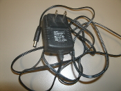 AOK AC Adapter. Used. AK01G-1200030U. OEM. AC Charger. Input: 100-240V, 50/60Hz, 0.2A. Output: 12V, 0.3A. 0829R.