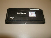Intel Pentium II Processor. 233Mz. New. 80522PX233512, SL2HD, 98080311-0408, Malay. 11S0K2599ZJ14MC835A00.